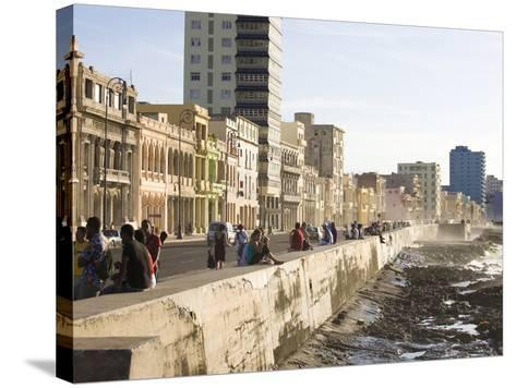 View Along the Malecon, People Sitting on the Seawall Enjoying the Evening Sunshine, Havana, Cuba-Lee Frost-Stretched Canvas Print