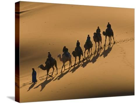Camel Caravan Riding Through the Sand Dunes of Merzouga, Morocco, North Africa, Africa-Michael Runkel-Stretched Canvas Print
