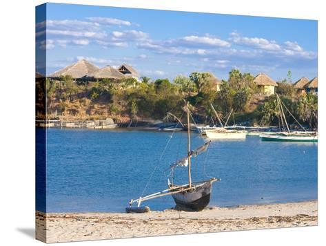 Outrigger Boat Lying on Bank of Sand, Antsanitian Beach Resort, Mahajanga, Madagascar-Michael Runkel-Stretched Canvas Print