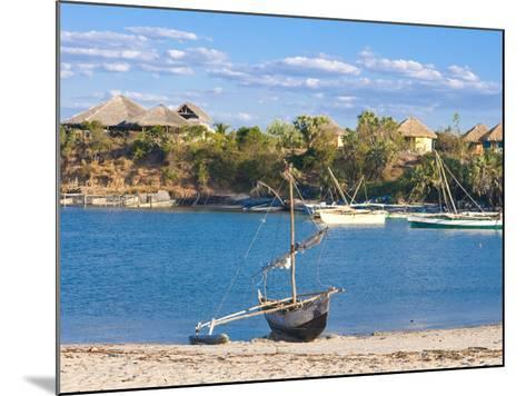 Outrigger Boat Lying on Bank of Sand, Antsanitian Beach Resort, Mahajanga, Madagascar-Michael Runkel-Mounted Photographic Print