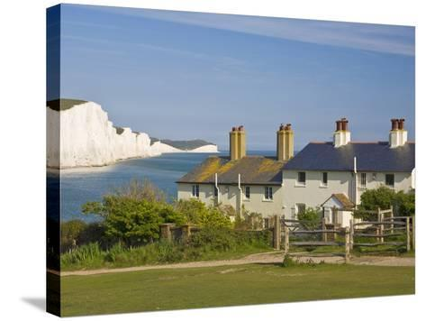 View of the Seven Sisters Cliffs, the Coastguard Cottages on Seaford Head, East Sussex-Neale Clarke-Stretched Canvas Print
