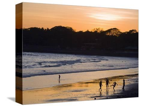 People Playing Football on the Beach at La Libertad, Pacific Coast, El Salvador, Central America-Christian Kober-Stretched Canvas Print