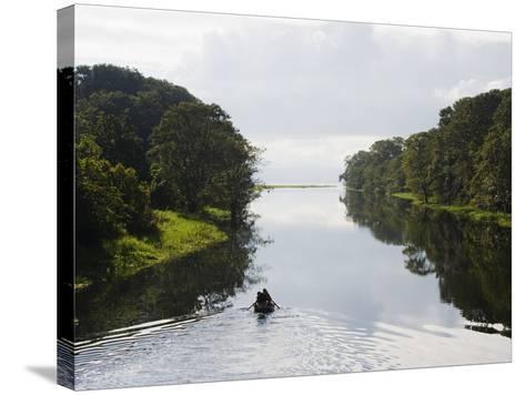 Boat on Lago De Yojoa, Lake Yojoa, Honduras, Central America-Christian Kober-Stretched Canvas Print