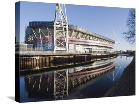 Reflection of Millennium Stadium in River Taff, Cardiff, Wales, United Kingdom, Europe-Christian Kober-Stretched Canvas Print