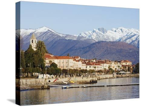 Snow Capped Mountains Above Stresa Waterfront, Lake Maggiore, Italian Lakes, Piedmont-Christian Kober-Stretched Canvas Print
