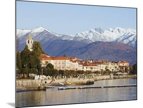 Snow Capped Mountains Above Stresa Waterfront, Lake Maggiore, Italian Lakes, Piedmont-Christian Kober-Mounted Photographic Print