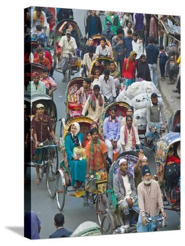 Busy Rickshaw Traffic on a Street Crossing in Dhaka, Bangladesh, Asia-Michael Runkel-Stretched Canvas Print