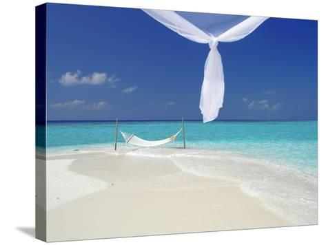 Hammock Hanging in Shallow Clear Water, the Maldives, Indian Ocean, Asia-Sakis Papadopoulos-Stretched Canvas Print