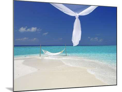 Hammock Hanging in Shallow Clear Water, the Maldives, Indian Ocean, Asia-Sakis Papadopoulos-Mounted Photographic Print
