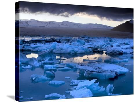 Blue Icebergs Floating on the Jokulsarlon Glacial Lagoon at Sunset, South Iceland, Iceland-Lee Frost-Stretched Canvas Print