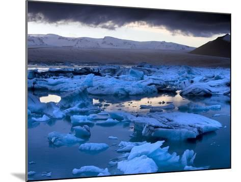 Blue Icebergs Floating on the Jokulsarlon Glacial Lagoon at Sunset, South Iceland, Iceland-Lee Frost-Mounted Photographic Print