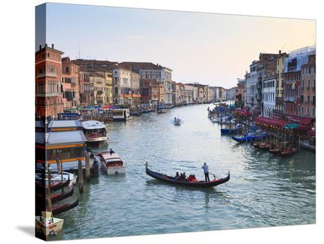 A Gondola Crossing the Grand Canal, Venice, UNESCO World Heritage Site, Veneto, Italy, Europe-Amanda Hall-Stretched Canvas Print