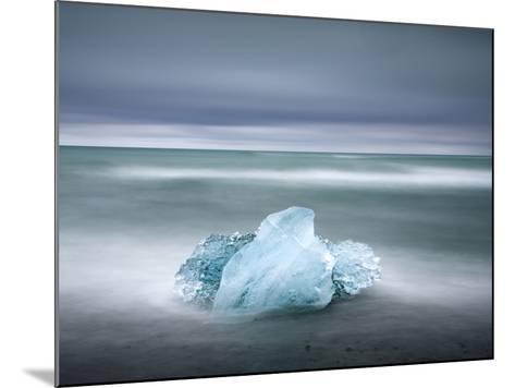 Piece of Glacial Ice Washed Ashore By the Incoming Tide Near Glacial Lagoon at Jokulsarlon, Iceland-Lee Frost-Mounted Photographic Print