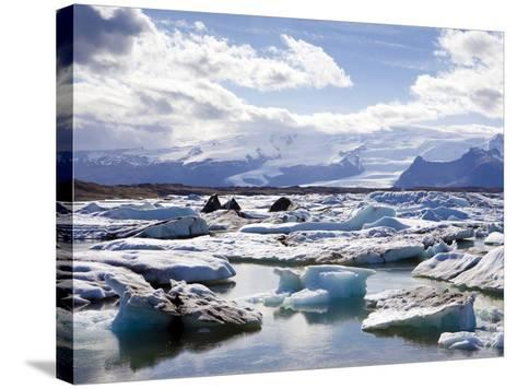 Icebergs in Glacial Lagoon at Jokulsarlon, Iceland, Polar Regions-Lee Frost-Stretched Canvas Print