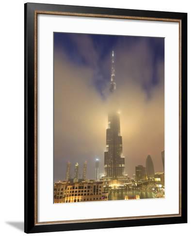 Burj Khalifa Illuminates the Clouds and Surrounding Skyline at Night, Downtown, Dubai, Uae-Amanda Hall-Framed Art Print