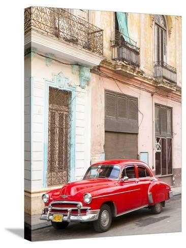 Restrored Red American Car Pakred Outside Faded Colonial Buildings, Havana, Cuba-Lee Frost-Stretched Canvas Print