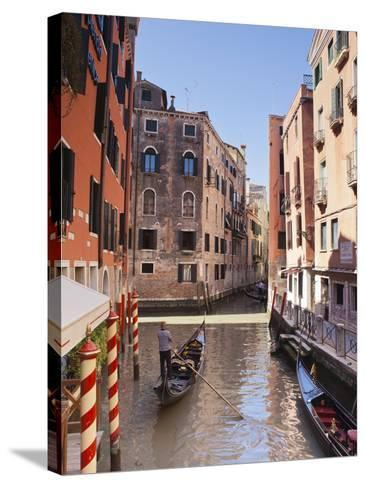 A Gondola on a Canal in Venice, UNESCO World Heritage Site, Veneto, Italy, Europe--Stretched Canvas Print