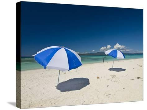 Parasols at the Beautiful Beach in Nosy Iranja, a Little Island Near Nosy Be, Madagascar--Stretched Canvas Print