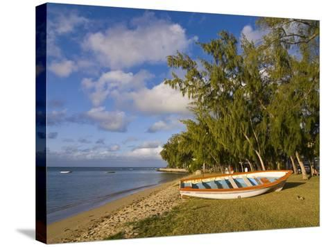Fishing Boat on the Beach of Anse Aux Anglais in the Island of Rodrigues, Mauritius--Stretched Canvas Print