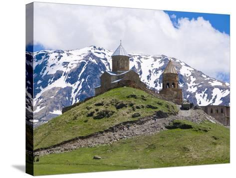 Famous Tsminda Sameba Church, Kazbegi, Georgia, Caucasus, Central Asia, Asia--Stretched Canvas Print