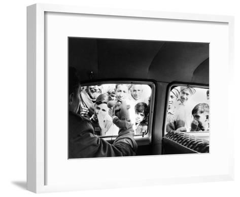 Indian children looking into puppeteer Bil Baird's car, March 1962.-James Burke-Framed Art Print