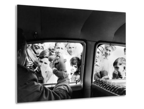 Indian children looking into puppeteer Bil Baird's car, March 1962.-James Burke-Metal Print
