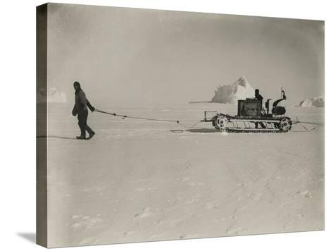 Explorers Guide a Motorized Sledge Hauling Supplies-Herbert Ponting-Stretched Canvas Print