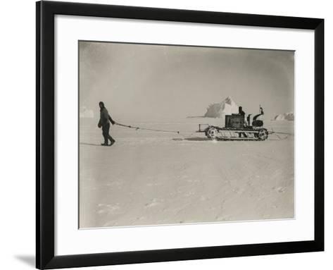 Explorers Guide a Motorized Sledge Hauling Supplies-Herbert Ponting-Framed Art Print