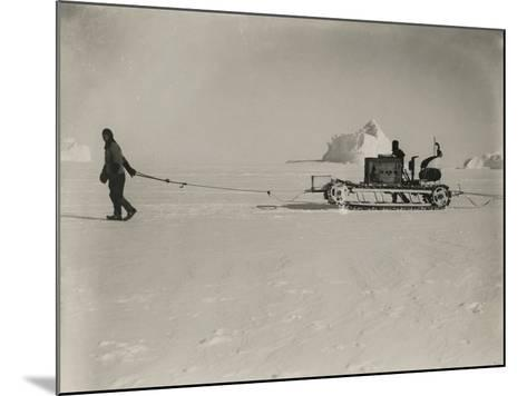 Explorers Guide a Motorized Sledge Hauling Supplies-Herbert Ponting-Mounted Photographic Print