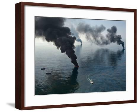 Smoke rises from surface oil being burned by cleanup crews.-Joel Sartore-Framed Art Print