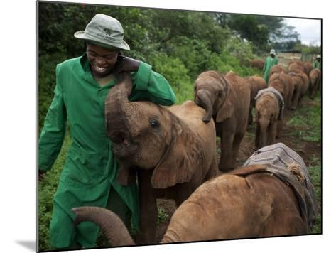 Elephant Orphans Form Intense Bonds With Their Caregivers and Vice Versa-Michael Nichols-Mounted Photographic Print