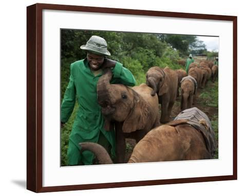 Elephant Orphans Form Intense Bonds With Their Caregivers and Vice Versa-Michael Nichols-Framed Art Print