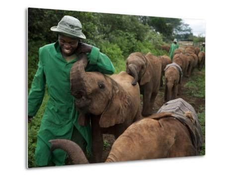 Elephant Orphans Form Intense Bonds With Their Caregivers and Vice Versa-Michael Nichols-Metal Print