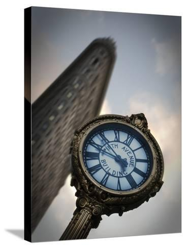 A Large Clock in Front If the Flatiron Building on 5th and Broadway-Keith Barraclough-Stretched Canvas Print