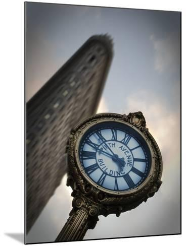 A Large Clock in Front If the Flatiron Building on 5th and Broadway-Keith Barraclough-Mounted Photographic Print