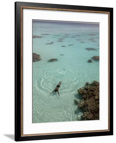 A Swimmer at a Resort on the Fakarava Atoll-Aaron Huey-Framed Art Print