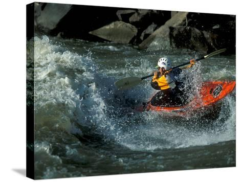 A River Kayak Spins Off a Wave-Robbie George-Stretched Canvas Print