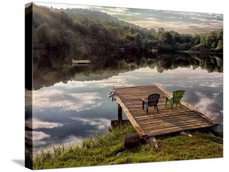 Two Chairs on a Small Dock on a Calm Lake with Cloud Reflections-Amy & Al White & Petteway-Stretched Canvas Print