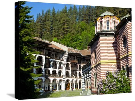 Courtyard, Dormitories and Church of the Nativity, Rila Monastery, UNESCO World Heritage Site, Nest-Dallas & John Heaton-Stretched Canvas Print