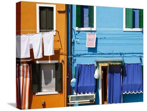Colourfully Painted Houses Situated on Canal Banks on the Island of Burano, Located Near Venice, Ve-Kimberley Coole-Stretched Canvas Print