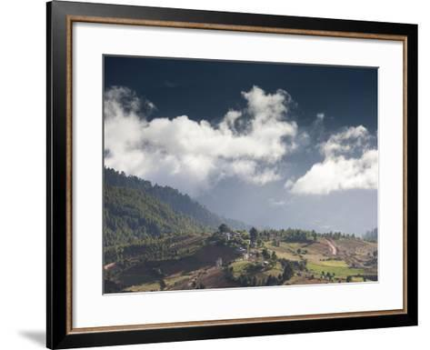 Village of Shingyer Against a Dramatic Backdrop of Mountains and Clouds, Phobjikha Valley, Bhutan, -Lee Frost-Framed Art Print