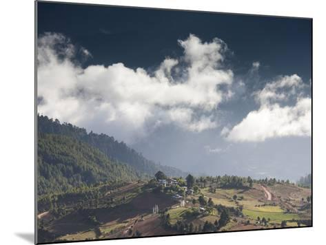 Village of Shingyer Against a Dramatic Backdrop of Mountains and Clouds, Phobjikha Valley, Bhutan, -Lee Frost-Mounted Photographic Print