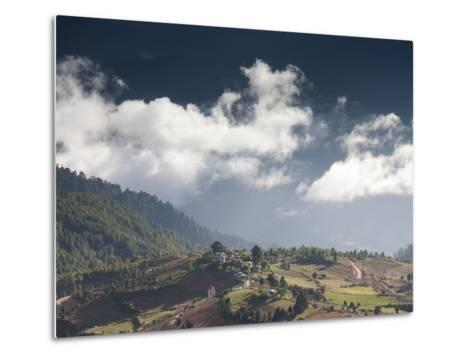 Village of Shingyer Against a Dramatic Backdrop of Mountains and Clouds, Phobjikha Valley, Bhutan, -Lee Frost-Metal Print