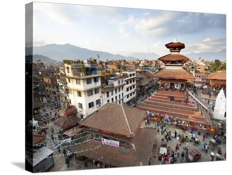 View over Durbar Square from Rooftop Cafe Showing Temples and Busy Streets, Kathmandu, Nepal, Asia-Lee Frost-Stretched Canvas Print