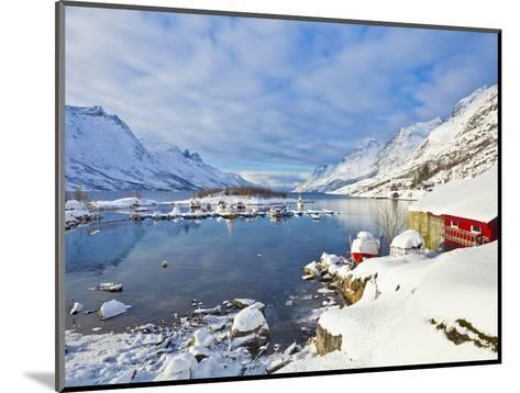 Snow Covered Mountains, Boathouse and Moorings in Norwegian Fjord Village of Ersfjord, Kvaloya Isla-Neale Clark-Mounted Photographic Print