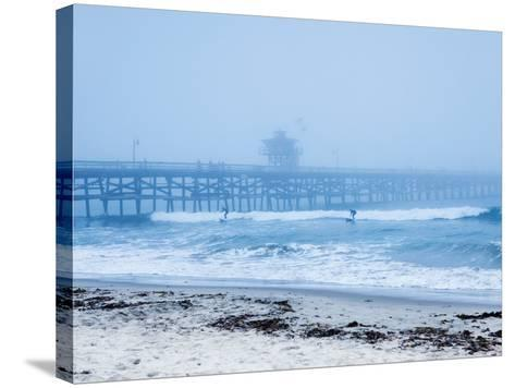 San Clemente Pier with Surfers on a Foggy Day, California, United States of America, North America-Mark Chivers-Stretched Canvas Print