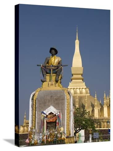Statue of King Setthathirat with Pha That Luang in the Background, Vientiane, Laos, Indochina, Sout-Richard Maschmeyer-Stretched Canvas Print