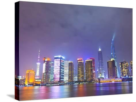 Pudong Skyline at Night across the Huangpu River, Shanghai, China, Asia-Amanda Hall-Stretched Canvas Print