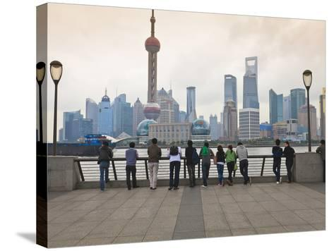 People Viewing the Pudong Skyline and the Oriental Pearl Tower from the Bund, Shanghai, China, Asia-Amanda Hall-Stretched Canvas Print