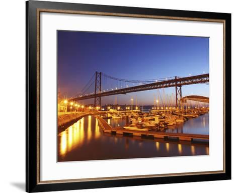 Boats on the River Tagus Move at Night in the Doca De Santa Amaro Marina under the 25 April Bridge,-Stuart Forster-Framed Art Print